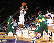 Kansas State guard Akeem Wright (34) puts up a shot over Cleveland State's Carlos English (1) in the second half at Bramlage Coliseum in Manhattan, Kansas, December 5, 2006.  K-State beat the Vikings 93-60.<br />