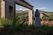 Brumadinho, Minas Gerais, Brazil, 26 Jan 2019: Nuns observe the damage caused by the mud after breaking the dam in the rural neighborhood Córrego do Feijão. The tailings dam, which was located at the Córrego do Feijão mine in Brumadinho, broke on Friday (25). The muddy sea swept the local community and part of the Valley's administrative center and cafeteria. Among the victims are people living in the area and employees of the mining company. The vegetation and rivers were hit. Photo: Avener Prado