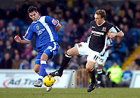 Photo: Alan Crowhurst.<br />Cardiff City v Hull FC. Coca Cola Championship. 18/02/2006. <br />Joe Ledley (R) and Mark Noble both challenge fo the ball.