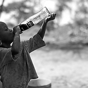 """""""Coca Cola""""                                                       Tanzania<br />  She put it to her lips and drank the entire Coke in one shot!"""