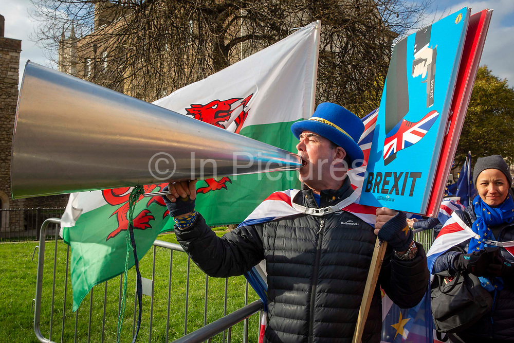 Steve Bray shouts Stop Brexit with a loud hailer at the TV studios  with a Sodem Action sign . he is a  pro EU demonstrators who have been outside parliament on a daily basis since September 2017 after the country voted to leave the European Union. House of Commons, Westminster, London, United Kingdom