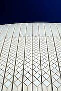 The Sydney Opera House is covered in small, off-white and white ceramic tiles. Sydney, Australia