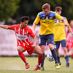 BRISBANE, AUSTRALIA - MARCH 4: Christopher Hatfield of Thunder is tackled by Zelfy Nazary of Olympic during the NPL Queensland Senior Mens Round 5 match between Olympic FC and SWQ Thunder at Goodwin Park on March 4, 2017 in Brisbane, Australia. (Photo by Patrick Kearney/Olympic FC)