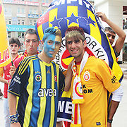 Galatasaray's and Fenerbahce's supporters friendship before the match  their Turkish Super Cup 2012 soccer derby match Galatasaray between Fenerbahce at the Kazim Karabekir stadium in Erzurum Turkey on Sunday, 12 August 2012. Photo by TURKPIX