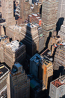 US, New York City. View from the Empire State Building observation deck. Empire State Building casting a shadow.