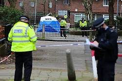 © Licensed to London News Pictures. 26/01/2021. London, UK. Police officers guard a crime scene on Holland Walk in Islington, north London after a fatal stabbing of a teenage boy. Police were called to Holland Walk on Monday 25 January at approximately 17:30GMT to a report of a stabbing. Officers attended with London Ambulance Service and helicopter emergency medical service (HEMS), and found a teenage boy suffering from a stab injury. Despite efforts by emergency services he was sadly pronounced dead at the scene a short while later. Photo credit: Dinendra Haria/LNP