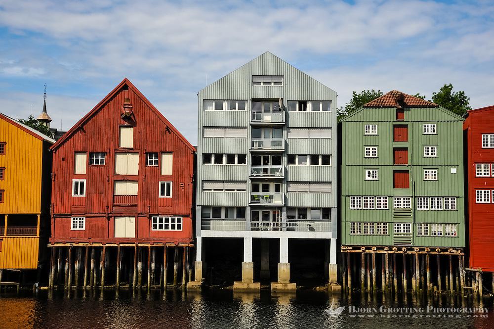 Norway, Sør-Trøndelag, Trondheim. Nidelva river from Bakklandet. Warehouses.