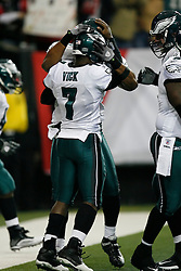 Philadelphia Eagles quarterback Michael Vick #7 is congratulated by teammates after scoring a touchdown during the NFL game between the Philadelphia Eagles and the Atlanta Falcons on December 6th 2009. The Eagles won 34-7 at The Georgia Dome in Atlanta, Georgia. (Photo By Brian Garfinkel)