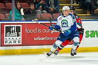KELOWNA, BC - OCTOBER 16:  Carson Sass #7 of the Kelowna Rockets checks Hayden Ostir #26 of the Swift Current Broncos at Prospera Place on October 16, 2019 in Kelowna, Canada. (Photo by Marissa Baecker/Shoot the Breeze)