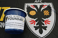 AFC Wimbledon Foundation collection bucket during the EFL Sky Bet League 1 match between AFC Wimbledon and Oldham Athletic at the Cherry Red Records Stadium, Kingston, England on 21 April 2018. Picture by Matthew Redman.