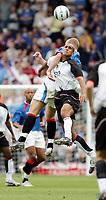 Fotball<br /> Treningskamp England<br /> <br /> Foto: Frances Leader, Digitalsport<br /> NORWAY ONLY<br /> <br /> Fulham v Rangers<br /> Pre-season friendly<br /> 24/08/2004.<br /> <br /> Fulham's  colides Zat Knight and Rangers Fernando Ricksen