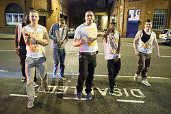 "© Licensed to London News Pictures . 21/10/2012 . Manchester , UK . 2nd from left: a student with "" BNP "" , "" IRA "" and a Swastika drawn on his Carnage UK t-shirt and "" Squeeze 4 a squirt "" written on his arm . Students attend a Carnage UK pub crawl at bars in Manchester 's Deansgate Locks with a fancy dress theme of "" Pimps and Hoes "" . The event has been criticised for encouraging binge drinking , sexism and anti-social behaviour . Photo credit : Joel Goodman/LNP"