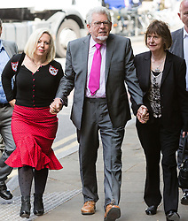 © Licensed to London News Pictures. 25/06/2014. London, UK. Artist and television personality, Rolf Harris arrives at Southwark Crown Court in London with his daughter Bindi Harris and niece Jenny on 25th June 2014. Jury deliberations continue as they attempt to reach unanimous verdicts in Harris's child sex abuse trial.. Photo credit : Vickie Flores/LNP