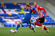 AFC Wimbledon attacker Shane McLoughlin (19) battles for possession with Sunderland attacker Aiden O'Brien (10) during the EFL Sky Bet League 1 match between AFC Wimbledon and Sunderland at Plough Lane, London, United Kingdom on 16 January 2021.