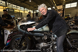 Alfredo Billy Cella with his 1986 FXE cafe racer at the Zombie Choppers display at Motor Bike Expo. Verona, Italy. Friday January 19, 2018. Photography ©2018 Michael Lichter.