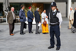 © licensed to London News Pictures. London, UK 24/04/2014. Barclays share holders queuing up for Barclays Annual General Meeting (AGM) outside Royal Festival Hall in London. Photo credit: Tolga Akmen/LNP