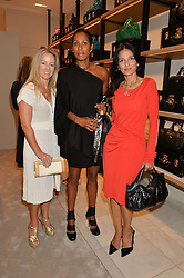 Left to right, ALISON HENRY, SHERRETT DAHLSTROM and YASMIN MILLS at a lunch hosted by Alice Naylor-Leyland and Tamara Beckwith in celebration of the Coach 2015 collection held at Coach, New Bond Street, London on 18th September 2014.