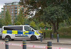© Licensed to London News Pictures 23/09/2021. Kidbrooke, UK, Grayston House in Astell Road over looks Cator Park, Police van parked in Cambert Way. (Unconfirmed reports that Sabina lived in this block). A large police cordon is still in place around Cator Park at Kidbrooke Village in Kidbrooke, South East London today after the body of 28 year old school teacher Sabina Nessa was found near a community centre. Police have said Sabina left her home and walked through Cator Park heading for the Depot pub at Pegler Square in Kidbrooke Village to meet a friend. Photo credit:Grant Falvey/LNP