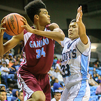 Ganado Hornet Jamal Coleman (34), left, looks for an open teammate under around Window Rock Scout Myron Wauneka (33) during the Tournament of Champions at the Window Rock Scout Event Center in Fort Defiance Wednesday