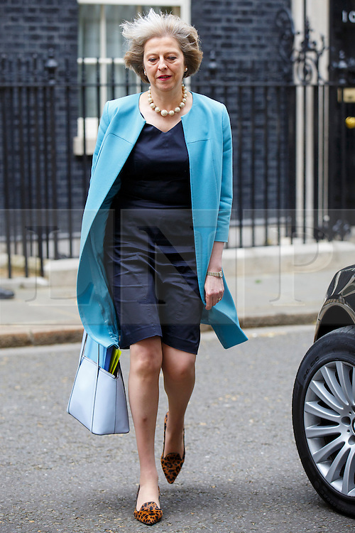 © Licensed to London News Pictures. 09/06/2015. Westminster, UK. Home Secretary THERESA MAY attending to a cabinet meeting in Downing Street on Tuesday, 9 June 2015. Photo credit: Tolga Akmen/LNP