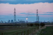 Electrical pylons in front of production tower in flames at the ConocoPhillips Oil Terminal at Seal Sands, Middlesbrough, North Yorkshire, United Kingdom.