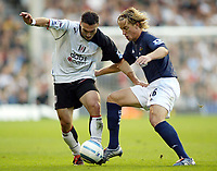 30/10/2004<br />FA Barclays Premiership - Fulham v Tottenham Hotspur - Craven Cottage, London<br />Fulham's Steed Malbranque and Tottenham Hotspur's Reto Ziegler fight for possession.<br />Photo:Jed Leicester/Back Page Images
