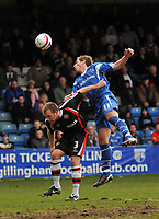 Photo: Tony Oudot/Richard Lane Photography. Gillingham v Shrewsbury Town. Coca-Cola Football League Two. 28/02/2009. <br /> Nicky Southall of Gillingham heads the ball challenged by Neil Ashton of Shrewsbury