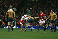 Australia's Peter Hynes collides with Tom James of Wales.. Invesco Perpetual series, Wales v Australia at the Millennium Stadium on Saturday 28th Nov 2009.  pic by Andrew Orchard, Andrew Orchard sports photography, .EDITORIAL USE ONLY