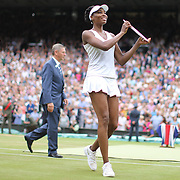 LONDON, ENGLAND - JULY 15:   Venus Williams of The United States shows her runners up trophy after the Ladies Singles Final in the Wimbledon Lawn Tennis Championships at the All England Lawn Tennis and Croquet Club at Wimbledon on July 15, 2017 in London, England. (Photo by Tim Clayton/Corbis via Getty Images)