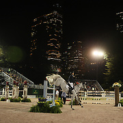 Kent Farrington, USA, riding Willow, in action during the $210,000 Central Park Show Jumping Grand Prix held in the Wollman Ice Rink. The event was part of the four Day Central Park Horse Show. Central Park, Manhattan, New York, USA. 18th September 2014. Photo Tim Clayton