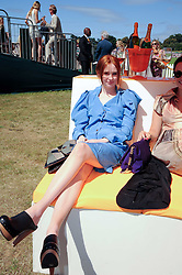 Left, KAREN GILLAN at the Veuve Clicquot Gold Cup polo final held at Cowdray Park, Midhurst, West Sussex on 18th July 2010.