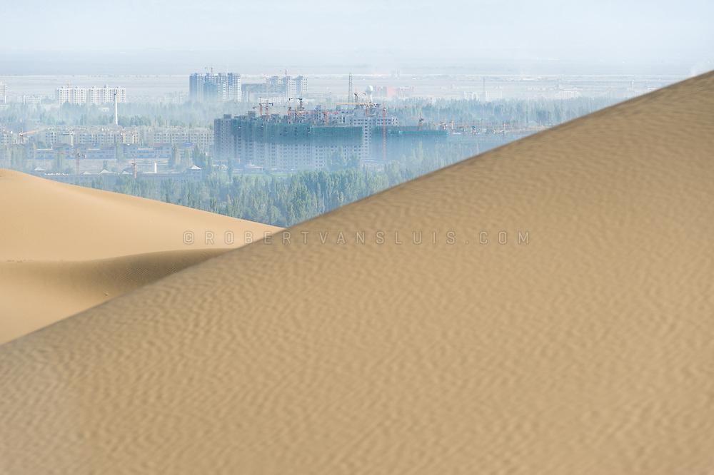 Construction enchroaching upon the Kumtag Desert, near Shanshan, Xinjiang, China