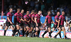 Hull FC players show their dejection at half time as they walk off 38-0 down against Wakefield Trinity Wildcats to later lose the game 72-10 during the Betfred Super League match at Belle Vue Stadium, Wakefield.