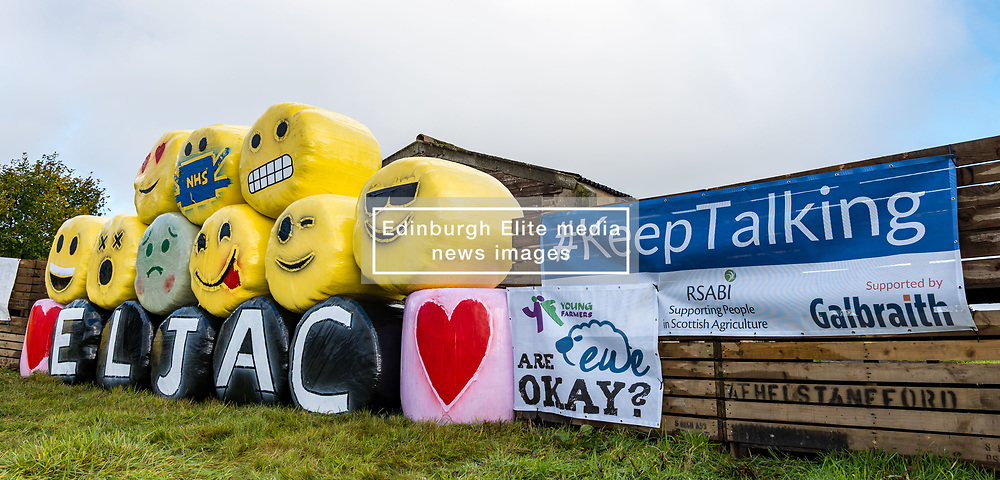 Athelstaneford, East Lothian, Scotland, United Kingdom, Bale Art 2020: East Lothian Junior Agricultural Club's bale art in support of charity RSABI, which supports people from Scottish agriculture emotionally, practically and financially. The yellow bale material was also bought in support of a children's cancer research charity. The theme this year is #keeptalking. <br /> Sally Anderson | EdinburghElitemedia.co.uk