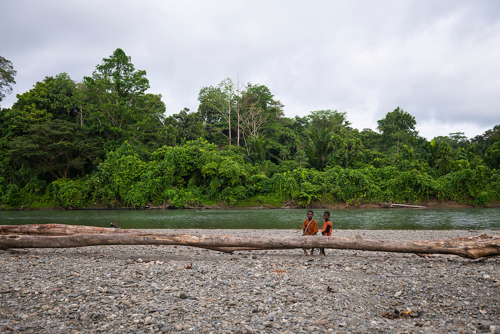 Two children on the banks of the Clay River in Likan, East Sepik Province, Papua New Guinea<br /><br />(June 21, 2019)