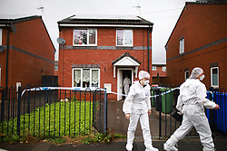 © Licensed to London News Pictures. 03/08/2021. Manchester, UK.  Scene on Redesmere Close, Droylsden where police say they were called to a report of a stabbing, early this morning (Friday 3rd August). It's understood that a 47 year old man died later in hospital and that a 21-year-old man has been arrested on suspicion of murder. Photo credit: Joel Goodman/LNP