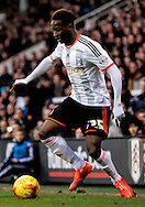 Moussa Dembélé dribbling during the Sky Bet Championship match between Fulham and Derby County at Craven Cottage, London, England on 28 February 2015. Photo by Matthew Redman.