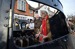 © under license to London News pictures. 07/11/2010. Two men fixing the engine on their vintage car. Vintage four-wheeled cars, tricars and motor tricycles taking part in the 77th London to Brighton Veteran Car Run (LBVCR) pass through Crawley, West Sussex today (Sun). The world's longest running motoring even, representing 24 nations, takes the extraordinary automobiles on the 60-mile run from Hyde Park in central London to the seafront on the Sussex resort of Brighton.  Photo credit should read: London News Pictures/LNP
