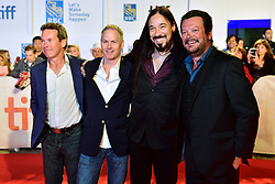 """The Tragically Hip, from left, Gord Sinclair, Johnny Fay, Rob Baker and Paul Langlois arrive on the red carpet for the movie """"Long Time Running"""" during the 2017 Toronto International Film Festival in Toronto, ON, Canada, on Wednesday, September 13, 2017. Photo by Frank Gunn/CP/ABACAPRESS.COM"""