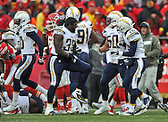 KANSAS CITY, MO - NOVEMBER 24:  Players of the San Diego Chargers celebrate after beating the Kansas City Chiefs on November 24, 2013 at Arrowhead Stadium in Kansas City, Missouri.  San Diego won 41-38. (Photo by Peter Aiken/Getty Images) *** Local Caption ***