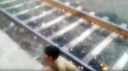 """Boy cheats death as train runs over him!<br /> <br /> A 13-year-old boy fell into the gap between the train and the platform while trying to board the train at Bamniya station of Jhabua, Madhya Pradesh, India. <br /> <br /> The incident around 6:30 am while the boy was trying to board the Mumbai-bound Janata Express, but lost his balance slipped into the gap.<br /> <br /> Before he could try to wriggle out of the gap between the platform and the tracks, the train departed. <br /> <br /> Eyewitnesses thought the boy was dead, but the boy had miraculous escape. He clung onto the platform wall till the train moved out of the platform. Much to the disbelief of the onlookers, he emerged unscathed from the tracks after that.<br /> <br /> Ravindra Kumar, the station master at Bāmnia, said: """"As soon as we received the information that someone has fallen on the tracks, I contacted the train guard and halted the train immediately. I must say the boy cheated death by his presence of mind.""""<br /> <br /> https://www.youtube.com/watch?v=KHLWw70FLpw<br /> ©Exclusivepix Media"""