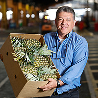 Proud trader displays pineapples at Melbourne's old wholesale market site in Footscray