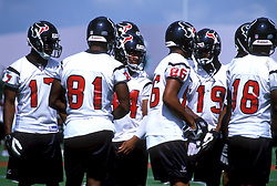 Stock photo of Texans team members on the field during practice