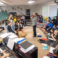Bob Ippel, the new executive director of Rehoboth Christian School, directs 7th-grade students in a Chattanooga Choo Choo rehearsal at the Mission House choir room in Rehoboth Wednesday.