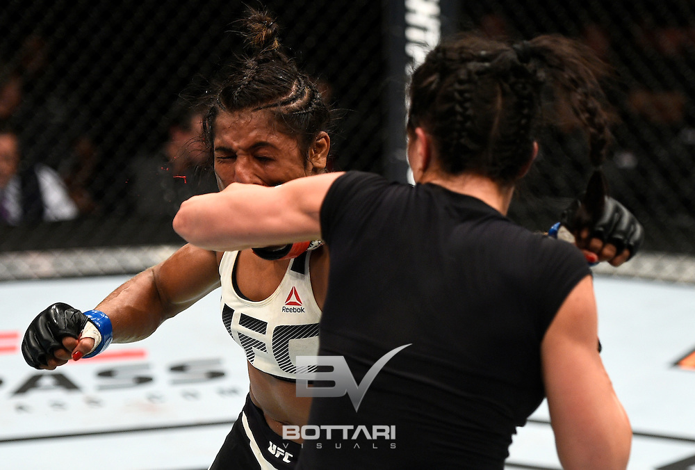 TORONTO, CANADA - DECEMBER 10:  (R-L) Valerie Letourneau of Canada punches Viviane Pereira of Brazil in their women's strawweight bout during the UFC 206 event inside the Air Canada Centre on December 10, 2016 in Toronto, Ontario, Canada. (Photo by Jeff Bottari/Zuffa LLC/Zuffa LLC via Getty Images)