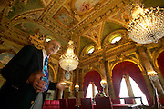 Newport RI, USA - A tour guide explains details in the dining room of the Breakers, the incedibly ornate 19th century Vanderbilt mansion of the guilded era in Newport.