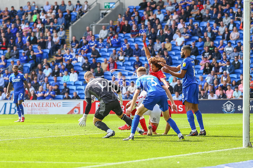 Cardiff City goalkeeper Dillon Phillips (1) collects the ball from Bristol City's Han-Noah Massengo (42) during the EFL Sky Bet Championship match between Cardiff City and Bristol City at the Cardiff City Stadium, Cardiff, Wales on 28 August 2021.