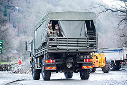 © Licensed to London News Pictures. 08/12/2015. Glen ridding UK. Picture shows the Army who dropped water to the residents of Glenridding earlier today where a massive clean up operation has started. Glenridding has been cut of from the outside world for four days with no water, electricity or telephone lines after huge torrents of water from the surrounding mountains destroyed roads leading to it & flooded the village centre. Photo credit: Andrew McCaren/LNP