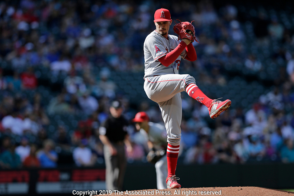 Los Angeles Angels starting pitcher Andrew Heaney works against the Seattle Mariners during the first inning of a baseball game, Saturday, June 1, 2019, in Seattle. (AP Photo/John Froschauer)