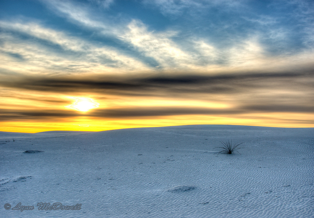 Simple Beauty, sunrise over a dune at White Sands National Monument.  The clouds were exquisite this morning.  Image was created using the High Dymanic Range technique